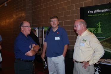 Dave Schuurman, chairman of Beneficial Reuse Management/GYPSOIL; Bob Paulson, senior environmental consultant with We Energies; and Gary Matney of  Beneficial Reuse Management/GYPSOIL (from left) visit between sessions at the Midwest Soil Improvement Symposium: Research and Practical Insights into Using Gypsum.